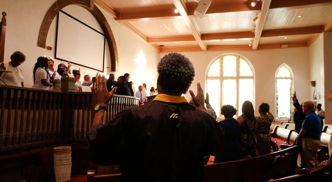 """Worshippers sing """"Amazing Grace"""" at the the First African Baptist Church in Tuscaloosa commemorate Bloody Tuesday during a service Sunday, June 3, 2018. On June 9, 1964, police officers used tear gas, and assisted by an angry mob, brutalized black citizens attempting to march from First African Baptist to the Tuscaloosa County Courthouse to protest segregated water fountains and restrooms in the new county courthouse. The event is now known as Bloody Tuesday. [Staff Photo/Gary Cosby Jr.]"""