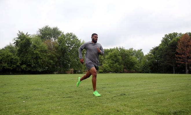 Ronald Robinson runs sprints June 2 in one of the fields at McCord Park, 333 E. Wilson Bridge Road in Worthington, which is in line for several renovations that are on track to begin in late summer. Robinson is a former Notre Dame football player and said he is trying to stay in shape now that he has graduated.
