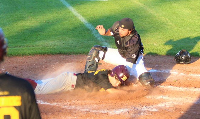 Wellington's Kaden Twyman tagged out at home by Denver's Matt Verdugo as he tries to score from first in the bottom of the third.