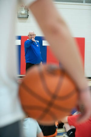 Zane Trace basketball coach Gary Kellough works with young athletes during his annual youth camp on June 2, 2021.