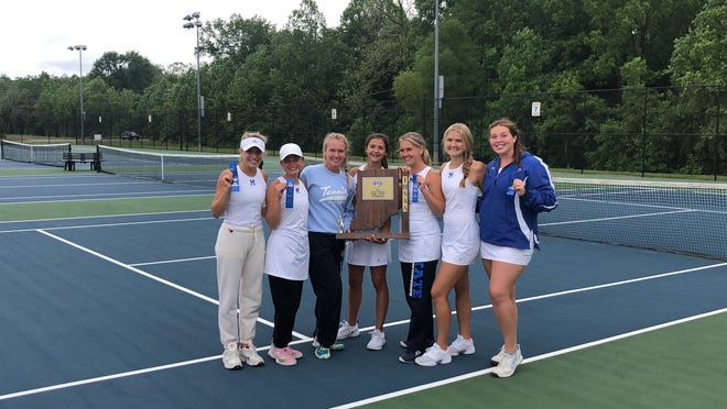 The Memorial girls' tennis team celebrates with the semistate trophy after defeating Columbus North 3-2. The Tigers will face South Bend St. Joseph in the state quarterfinals.