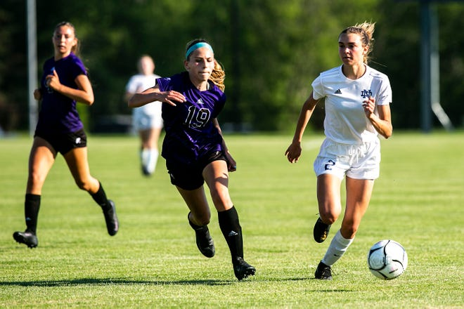 Iowa City Liberty's Layla Rouse, left, battles Burlington Notre Dame's Addison Parrott for a ball during a Class 2A substate regional semifinal girls' soccer game, Wednesday, June 2, 2021, at Liberty High School, in North Liberty, Iowa.