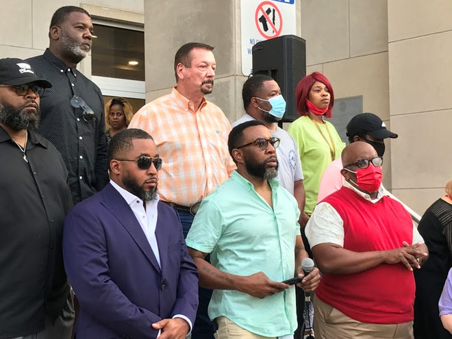 """William """"Napoleon"""" Edwards calls on law enforcement and city officials to do more to address crime in the city on the steps of the Jackson Police Department headquarters on Wednesday, June 2, 2021. Hobbs, 18, was killed just hours after graduating."""