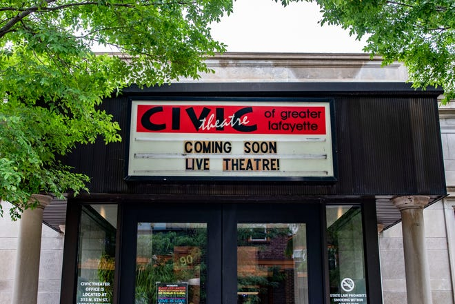 """""""Coming soon live theatre,"""" is seen on the marquee of the Civic Theatre of Greater Lafayette, Wednesday, June 2, 2021 in Lafayette, Ind. The theatre has been closed since March 2020 and looks to reopen in July."""