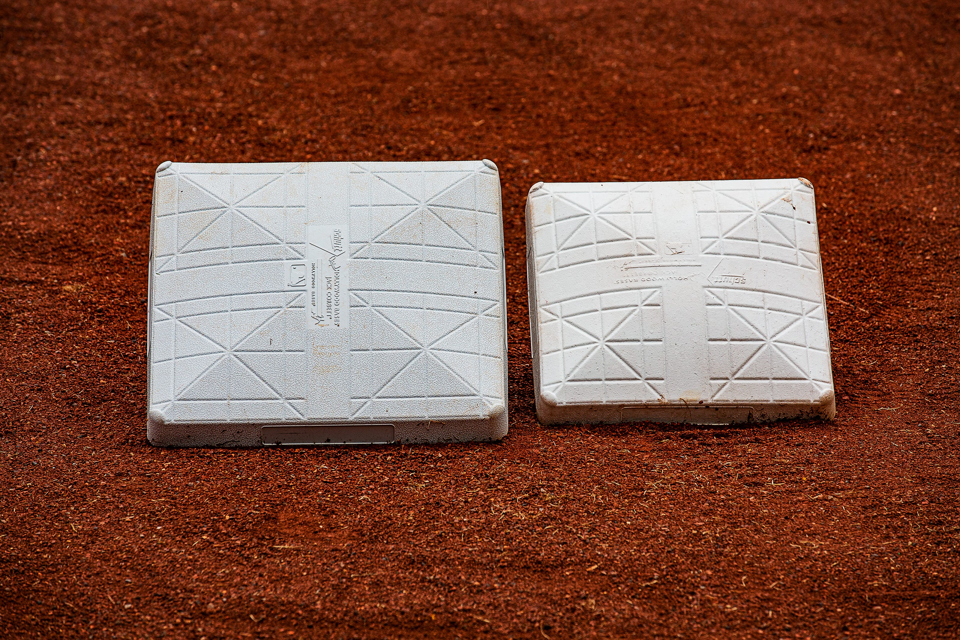 A game of inches altered by 2 square feet: Minor league teams using larger bases