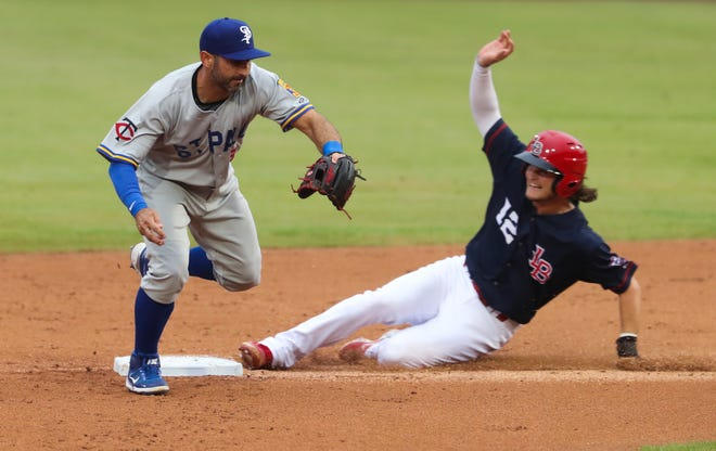 The Louisville Bats Brantley Bell (12) was safe at second as St. Paul Saints Daniel Descalso (13) tried to make a throw to first during their game at Slugger Field in Louisville, Ky. on June 2, 2021.
