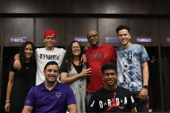 Josh Wynder poses with his family and LouCity coach Danny Cruz after signing his contract