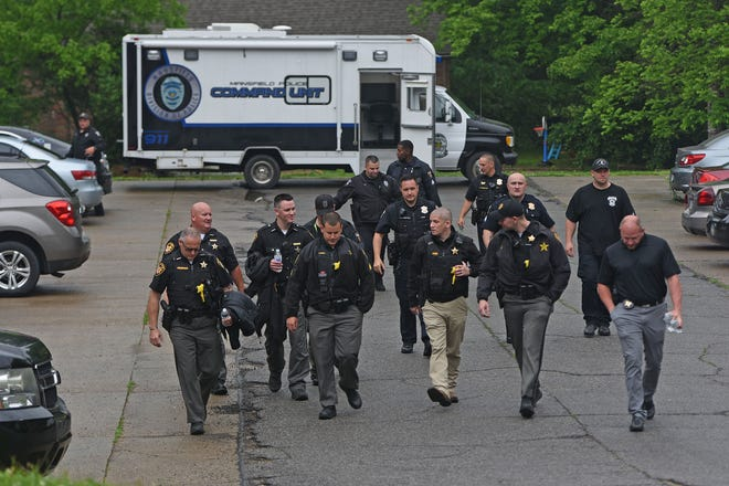 Law enforcement canvassed the Brookfield Drive area the morning of June 3 looking for information on a stabbing that took place in the neighborhood earlier.
