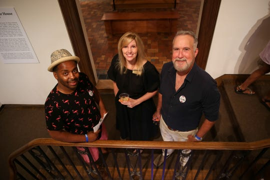 Vitus Shell, Kristin Brown and John Kennedy enjoy the grand reopening of the Masur Museum on May 27.