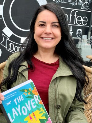 Nashville native Lacie Waldon wrote most of her debut novel, The Layover, on the job working as a flight attendant