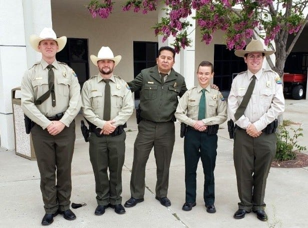 Newly commissioned rangers pose with Sal Gonzales, Park Ranger from Elephant Butte. Left to right: Austin Wilson, Cody Creager, Sal Gonzales, Zoe Gonzalez, and Aaron Cobas at the Law Enforcement Academy graduation ceremony.