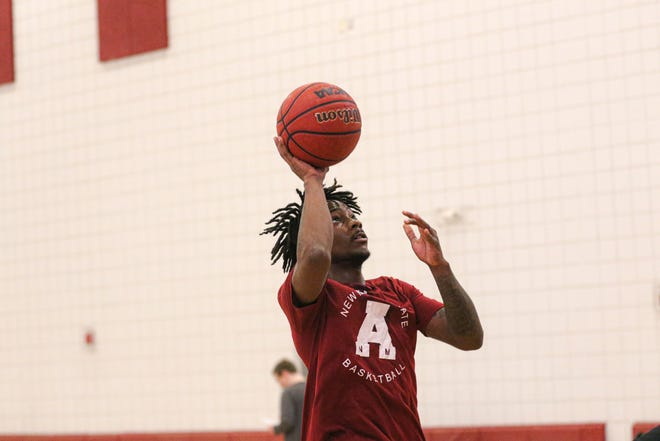 New Mexico State's Mario McKinney Jr. goes up for a floater during a team workout on June 3, 2021, in Las Cruces, New Mexico.