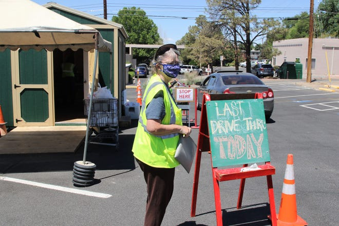 Bonnie Dallas Senior Center employee Betty Lewis works the drive-thru meal distribution site on June 3 at the Farmington facility. June 3 was the last day for drive-thru meals as the indoor dining room reopens on June 7.