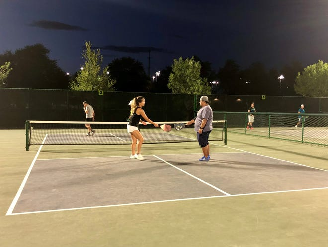 In pickleball, it doesn't matter what you do for a living or who you voted for. You play together, knocking paddles when someone makes a good shot.