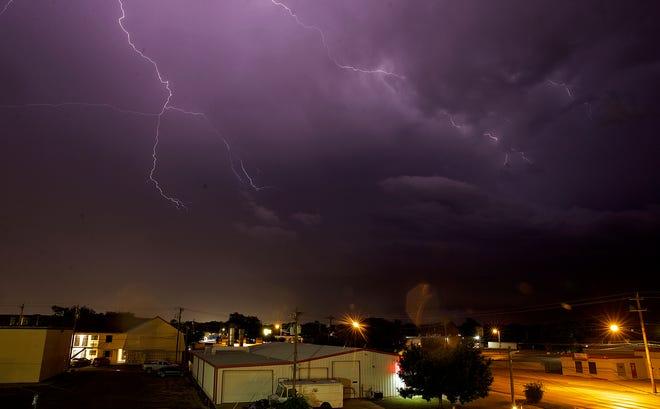 Lightning crosses the skies over San Angelo during an early morning thunderstorm Thursday, June 3, 2021.