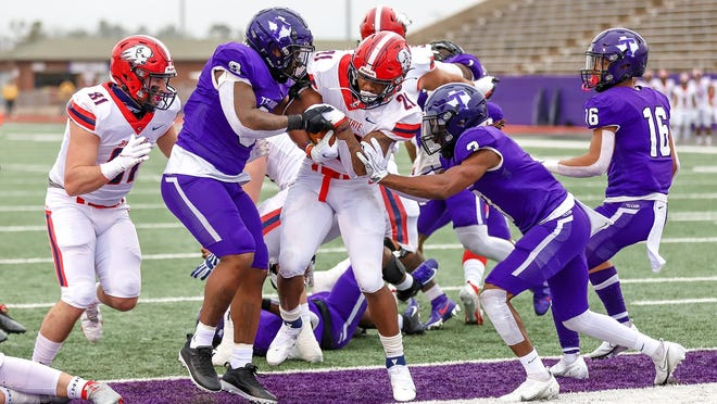 Dixie State's Quali Conley scores during the Trailblazers' upset of No. 22 Tarleton State.