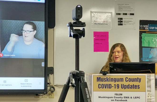 Dr. Kristina Loomis, an OBGYN with Genesis HealthCare, speaks during the Muskingum County Joint Unified Command Facebook Live presentation. On screen is sign langauge interpreter Alyson Lewis.