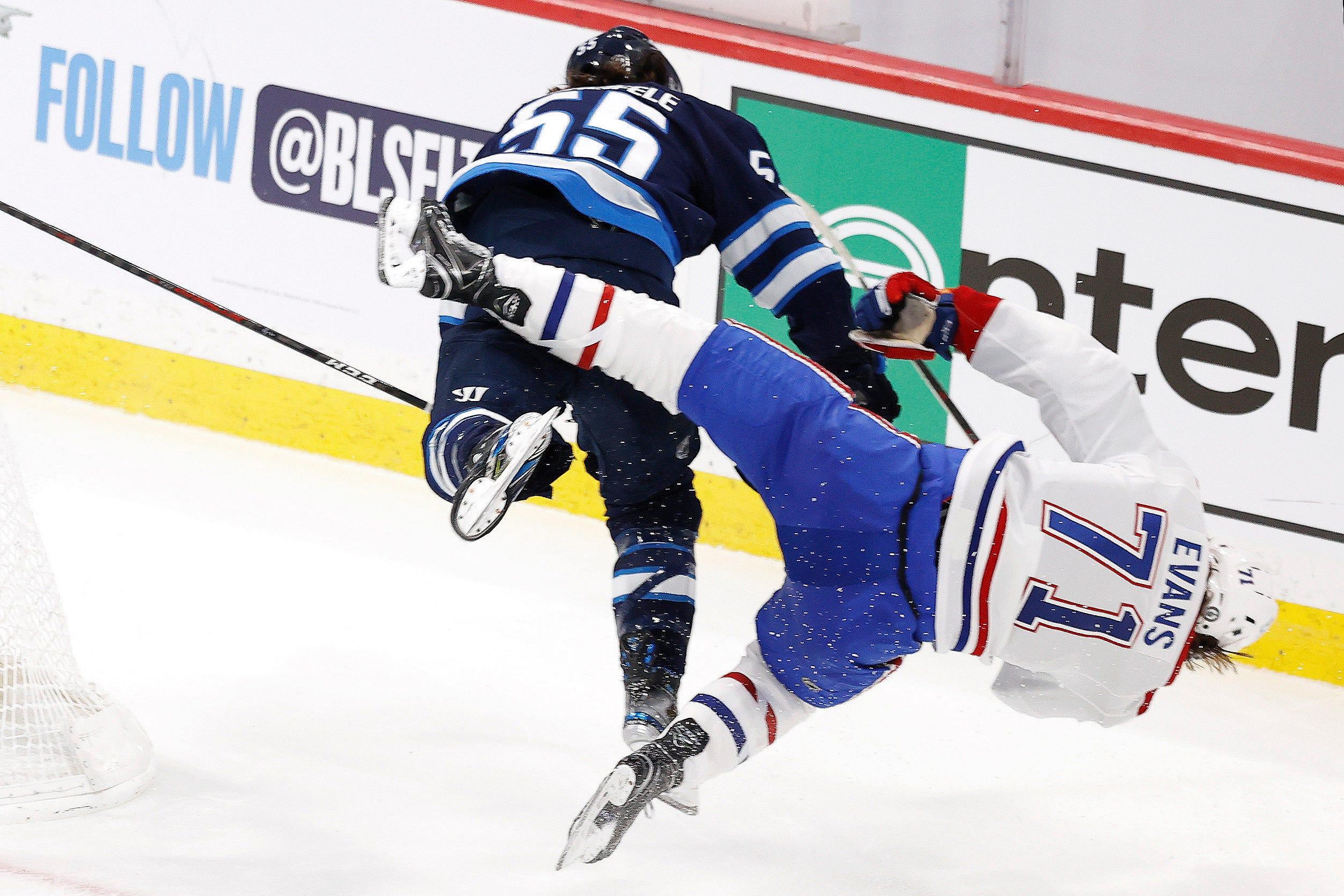 Montreal Canadiens' Jake Evans taken off on stretcher after hit by Winnipeg Jets' Mark Scheifele