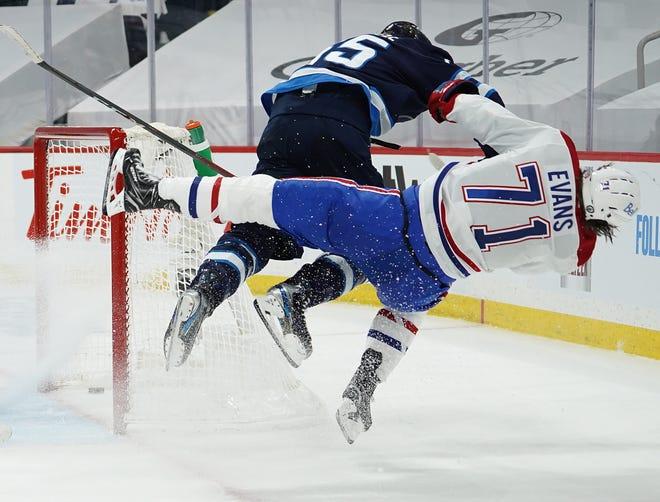 Jets center Mark Scheifele leveled Canadiens forward Jake Evans in Game 1 of their first-round series.