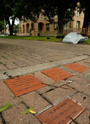 Bricks on the sidewalk outside the Williamson County courthouse on June 4  honor Civil War veterans and batallions. [AMERICAN-STATESMAN]