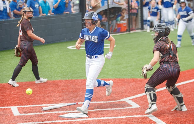 Georgetown's Madison Hartley steps on the plate to complete an inside-the-park home run against Aledo during a Class 5A state softball semifinal Friday at Glenn High School. The Eagles lost 8-5 to end their season.