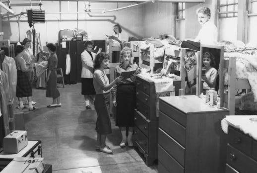 Young women reside in temporary quarters in the basement of the Moulton Hall dormitory in the early 1950s at Kent State University.