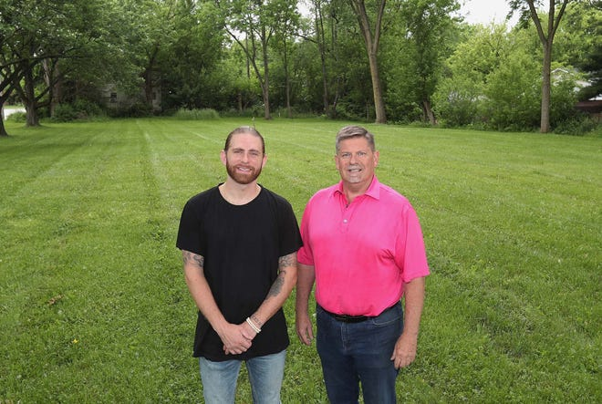 David Lane, left, and his father Chuck Lane, stand on the site where a new basketball training facility will be built on Bailey Road in Cuyahoga Falls. The business will be called The Lab By David Lane and will be owned by David Lane. The facility will be constructed next door to Harbor Castings, which is owned by Chuck Lane.
