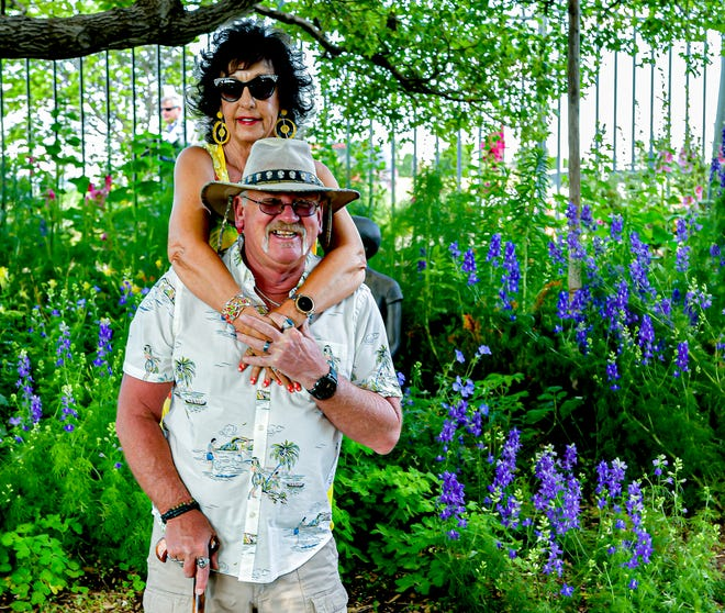 Karl and Lana Harm sightsee before the music begins at the Amarillo Botanical Gardens Thursday evening.