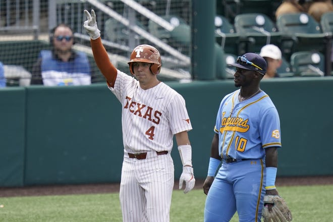 Texas catcher Silas Ardoin (4) celebrates next to Southern third baseman Zavier Moore (10) after his hit in the seventh inning of an NCAA regional tournament college baseball game,, Friday, June 4, 2021, in Austin, Texas.