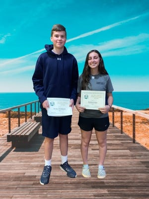 Hillsdale Middle School students Bradley Krichbaum and Rosalynn Mast with their Archie Griffin Awards and an added background.