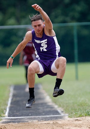 Sebring McKinley's Anthony Calderone competes in the long jump at the OHSAA Division III state track meet Friday at Westerville North High School.