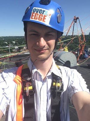 The author, 155 feet off the ground, covering a rappelling fundraiser