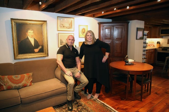 """Mortgage banker Sue Meitner meets with Realtor Jeff Lavine in a home in New Hope as they film a segment of """"Financing the American Dream."""""""