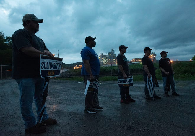 """United Steelworkers Local 10-74 members gather outside Styropek's gate while shining a sign on the plant that says """"Fair Contract Now!"""" in Potter Township."""