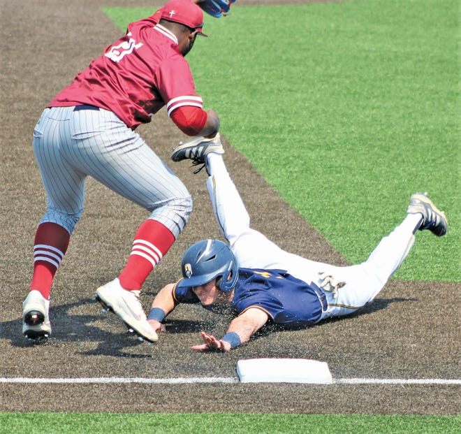 SOOOOO CLOSE: An Oklahoma Wesleyan University baserunner looks to find a safe haven at third base while the third baseman prepares to slap down a tag. OKWU slid into the NAIA World Series but came up just shy of advancing past the second day.