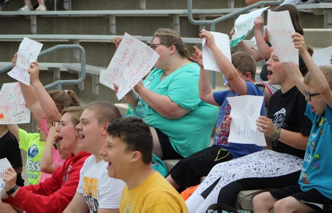 Those from the Arc of Sedgwick County cheer at a game for their favorite player, Hunter LaMunyon in 2019