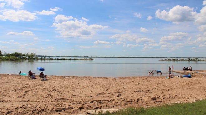 People enjoying the beach at El Dorado Lake