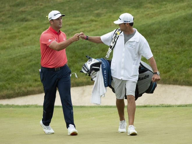 Jon Rahm celebrates a birdie chip on No. 16 at last year's Memorial. It turned into a bogey 4 when he was penalized for his ball moving slightly as he addressed the shot. Rahm learned of the penalty after he had won two holes later.