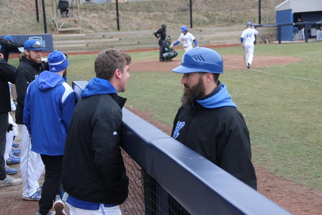 Eric Theisen talks to one of his players during a game in the 2021 season.