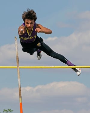 Onsted's TJ Wesley clears the bar during the pole vault event at the Lenawee County Championship meet on Tuesday in Onsted.