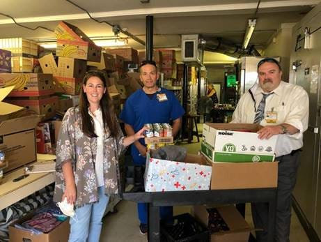 Food and money were collected for West Davidson Food Pantry. Pictured are Brandi Barnes, MSN, Thomas Brown, BSN, and Clyde Bristow, DNP.