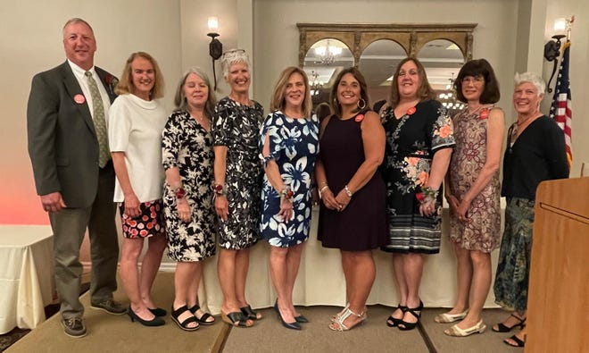 Shown in the photo Left to Right: Mike Modrovsky, Maria West, Kelly Box, Marianne Daniels, Rita Lang, Cathleen Taylor, Jill Dulay, Kathryn McAndrew, Chris Weigand.