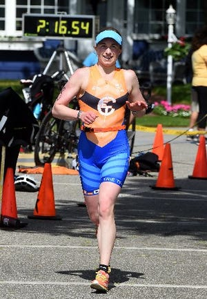 Desiree Terella of Fairview Township runs in the Edinboro Triathlon on June 8, 2019. The former Edinboro University swimmer was the women's champion of the three-sport competition that began and ended at Edinboro Lake's Pat Crawford Beach. Terella is registered to apear in Saturday's triathlon, which was cancelled last year because of COVID-19.