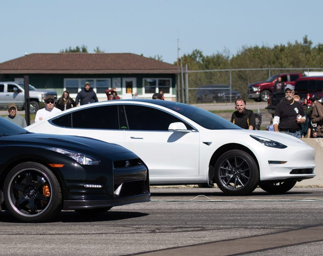 A Tesla electric car, right, was the talk of the Corry-Lawrence Airport drag races when it set the course record in August. Here, the Tesla is pictured at the second set of drag races in September.