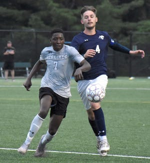 Herkimer College General Ali Somow (7) races Camden County College Cougar Niklas Kleinert (4) up the field to the ball during Thursday's NJCAA Division III men's soccer quarterfinal match.