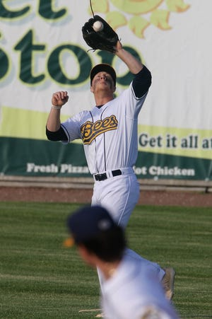 Burlington Bees Rome Wallace (29) makes the catch for an out during their game against the Alton River Dragons Thursday June 3, 2021, at Community Field.