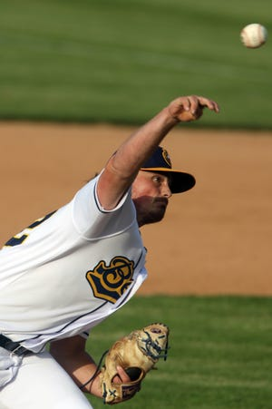 Burlington Bees McLain Harris (22) delivers a pitch during their game against the Alton River Dragons Thursday June 3, 2021, at Community Field.