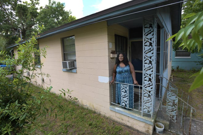 Kushanna Danglade stands on the front porch of her Jacksonville home that recently underwent roof and floor repairs needed because of Hurricane Irma damage in 2017. The work was done through the Northeast Florida Long-Term Recovery Organization.