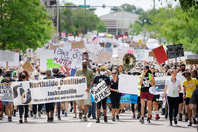 Protesters make their way down West Church Street heading to City Hall during a mid-June march. The marchers pushed for the removal of Confederate memorials as well as demanding justice during one of dozens of protests last summer.