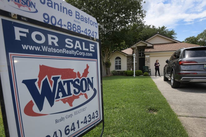Realtor Diana Galavis with Watson Realty visits one of her company's home listings off Southside Boulevard in the Baymeadows area.